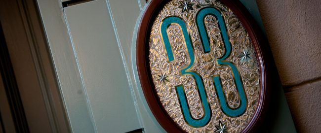 Club 33 sign. Photo credit Josh Hallett via Flikr; Creative Commons Attribution-ShareAlike 2.0 Generic (CC BY-SA 2.0)