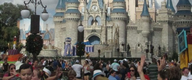 Crowds at the Hub in front of Magic Kingdom's Cinderella Castle.