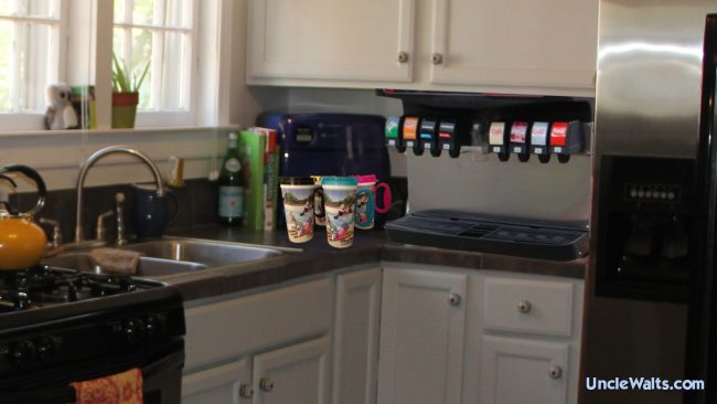 A Rapid Fill soda dispenser installed in a home. Photo includes images by Clubcola soda machine [CC BY-SA 3.0], via Wikimedia Commons, and orlando-florida.net.