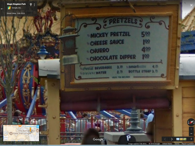 A cart selling churros and less important items at Disney's Magic Kingdom Park. Photo copyright 2018 Google / Street View.