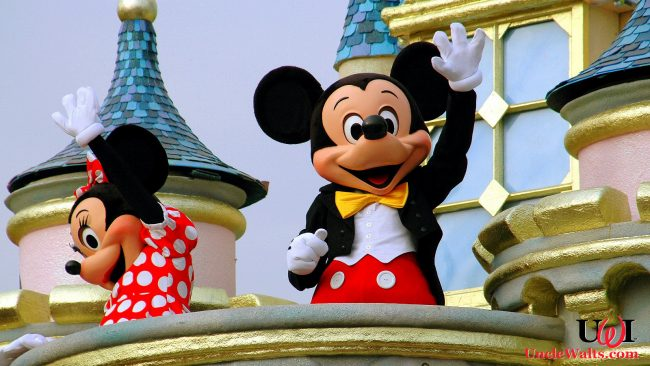 Mickey and Minnie wave to the crowds. Photo source Depositphotos_69250695_original.jpg.