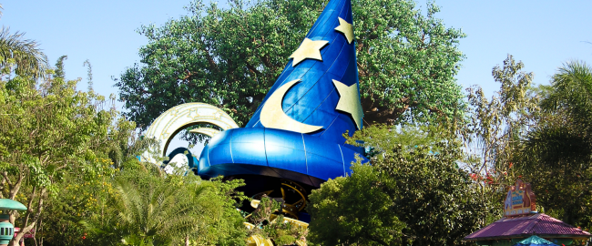 The Sorceror Mickey Hat in its new Animal Kingdom home. Photo credit Mfwills [CC BY-SA 3.0] via Wikimedia Commons and Katie Harbath [CC BY-NC-SA 2.0] via Flikr.