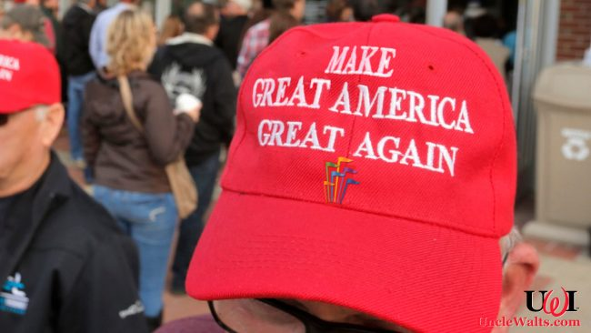 Six Flags owner John L. Ama wears his MGAGA hat. Adapted from photo by Gregory Rec/Staff Photographer/CNBC.