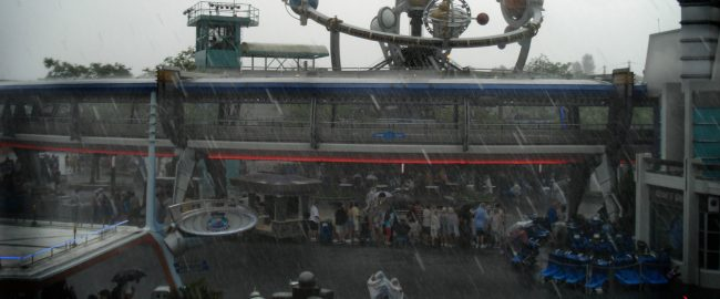 Inconsistently rainy day at Tomorrowland. Photo by Simon Kellogg [CC BY 2.0] via Flickr.