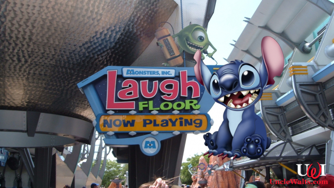 Monsters Inc. Laugh Floor at the Magic Kingdom Park, plus Stitch. Photo by Michael Gray [CC BY-SA 2.0] via Flickr, plus Stitch.
