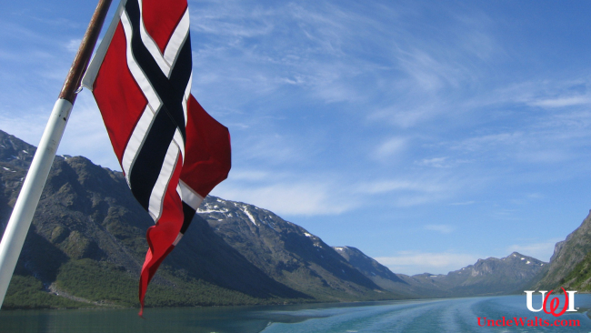 Norway (we presume) with a Norwegian flag flying. Photo by mroach [CC BY-SA 2.0] via Flickr.