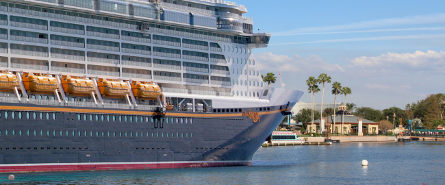 The Disney Dream anchored at Epcot. Photo courtesy Depositphotos & Theme Park Tourist [CC BY 2.0] via Wikimedia Commons.
