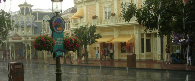 An extremely rare rain event at the Magic Kingdom. Photo by Andrew Evans [CC BY 2.0] via Flickr.