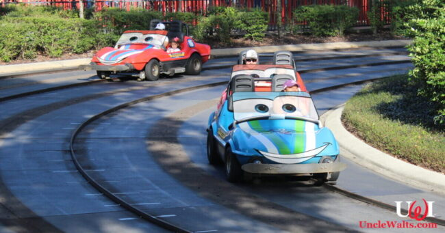 A rare photo of the sentient Speedway cars, taken just before the ride closed. Photo by Theme Park Tourist [CC BY 2.0] via Wikimedia Commons, modified.