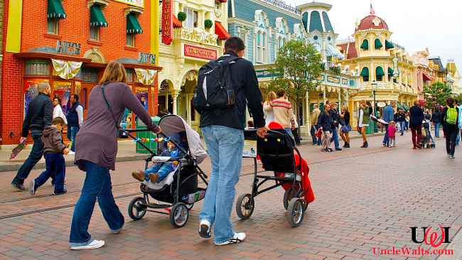 A family walks down Main Street with two non-rented children. Photo by DepositPhotos.