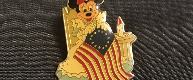 A pin shows Minnie Mouse with a racist flag. Photo by AntiquesNavigator.com.