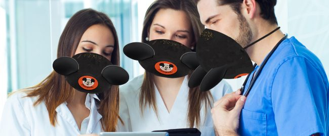 A medical team models the donated Mickey ear masks. Photo [CC0] via Pxhere.