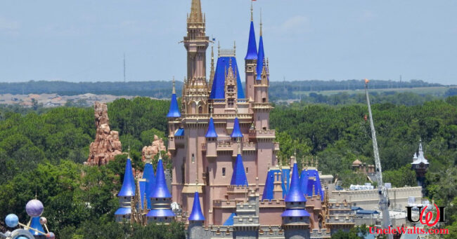 Vandals paint Cinderella Castle a hideous pink color. Photo by Laughing Place via Twitter.