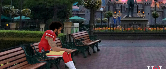 Colin Kaepernick, looking quite at home at Disneyland. Photo by Melissa Hillier [CC BY-2.0] via Wikimedia.