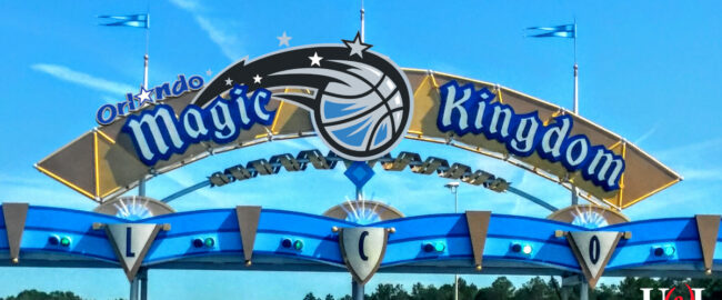 "The entrance arch to the newly-renamed ""Orlando Magic Kingdom."" Photo by Ivan Curra [CC BY-SA-3.0] via Wikimedia."